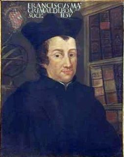 Painted portrait of a man wearing a hat and black robes posing in front of a bookcase